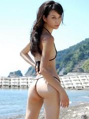 very skinny asian girl in bikini posing..