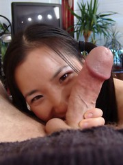 Almond tease sucking on some hard cock